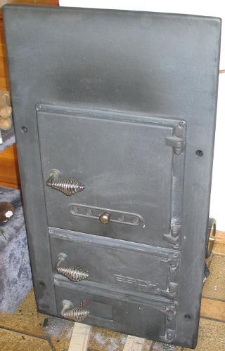 Gusseiserne Frontplatte vom Kaminkessel